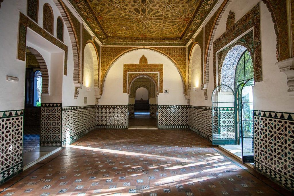 ornate room with tile in the real alcazar in sevilla spain