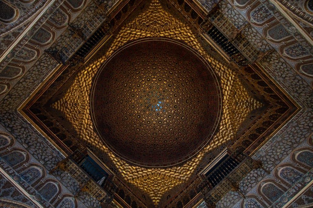 ornate gold ceiling in the real alcazar in sevilla spain