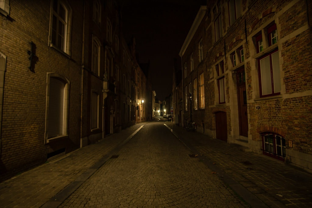 side street in bruges belgium at night