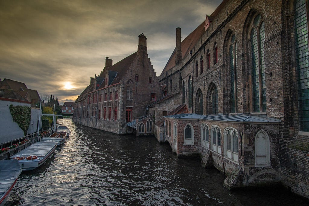 canal scene with brick buildings in bruges belgium