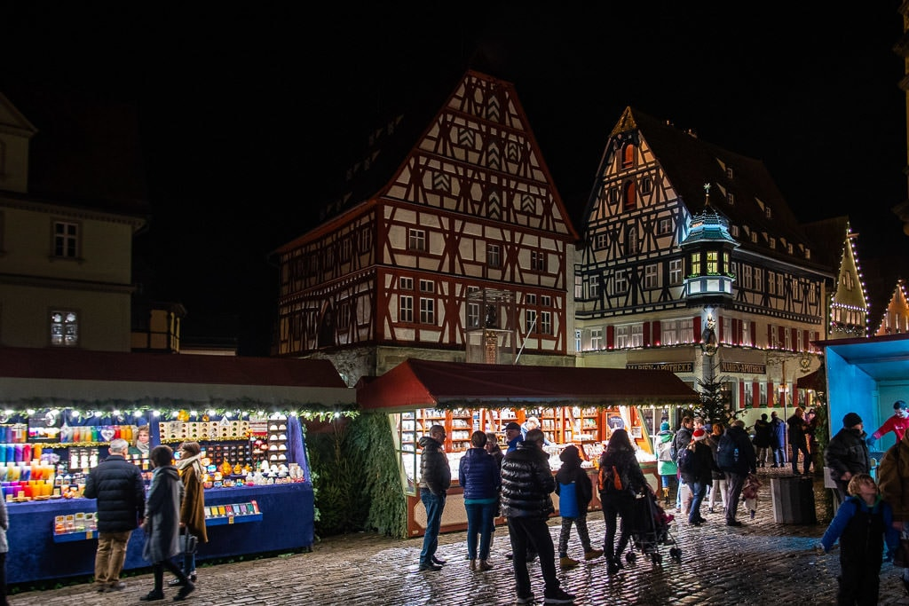 booths and medieval style buildings at rothenburg christmas markets in germany