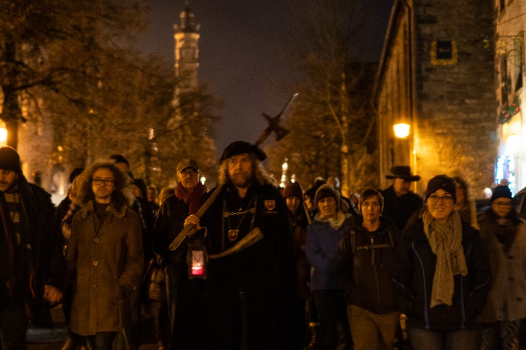 walking with group during night watchman tour in rothenburg germany