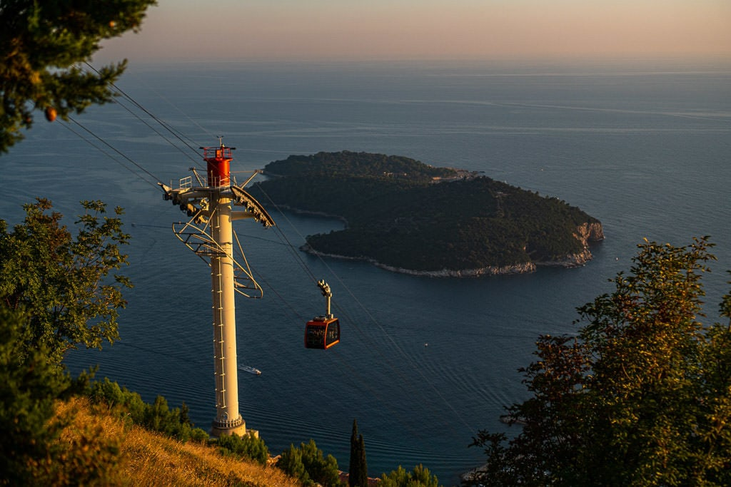 Cable car going up Mount Srd with Lokrum Island in the distance