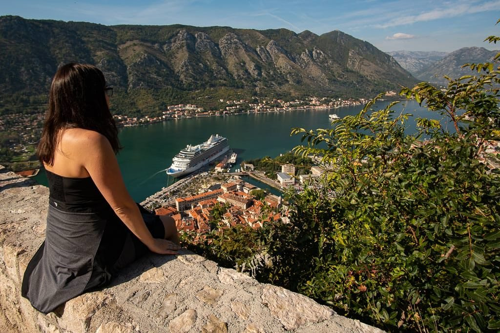 Brooke sitting on the Kotor City Wall enjoying the views out into Kotor Bay.