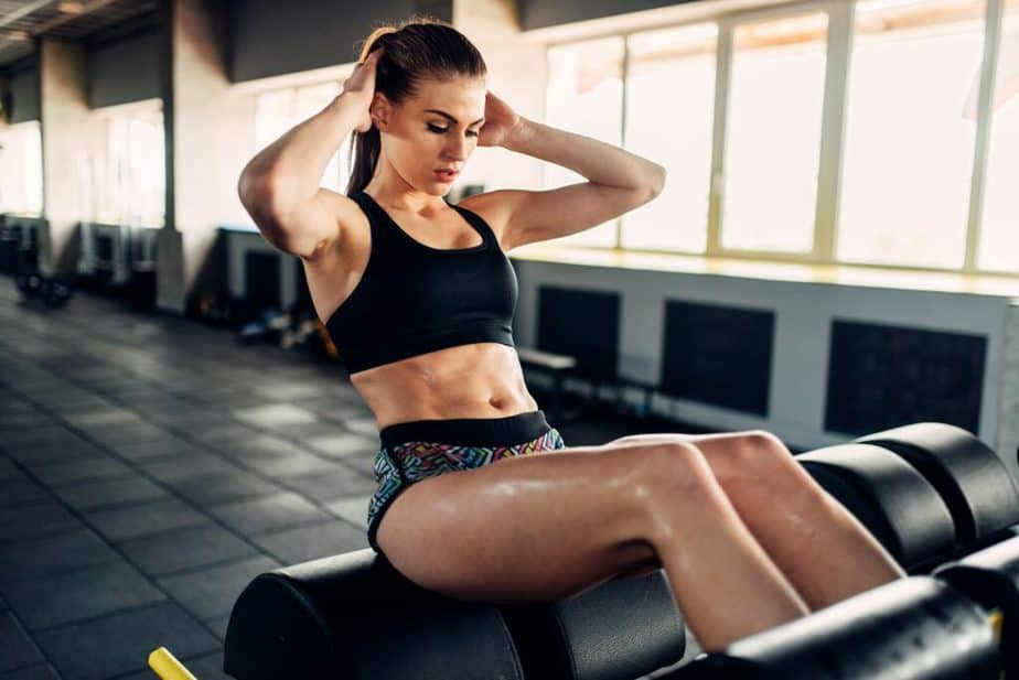 A fitness girl has a training at the gym