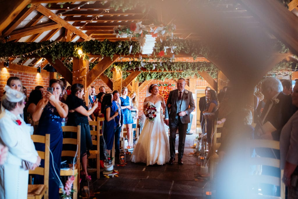 Kent wedding photographer The Ferry House Inn Harty Creative wedding Magical themed wedding DIY wedding crafts book themed Harry Potter Lord of the Rings wedding dress walking down the aisle