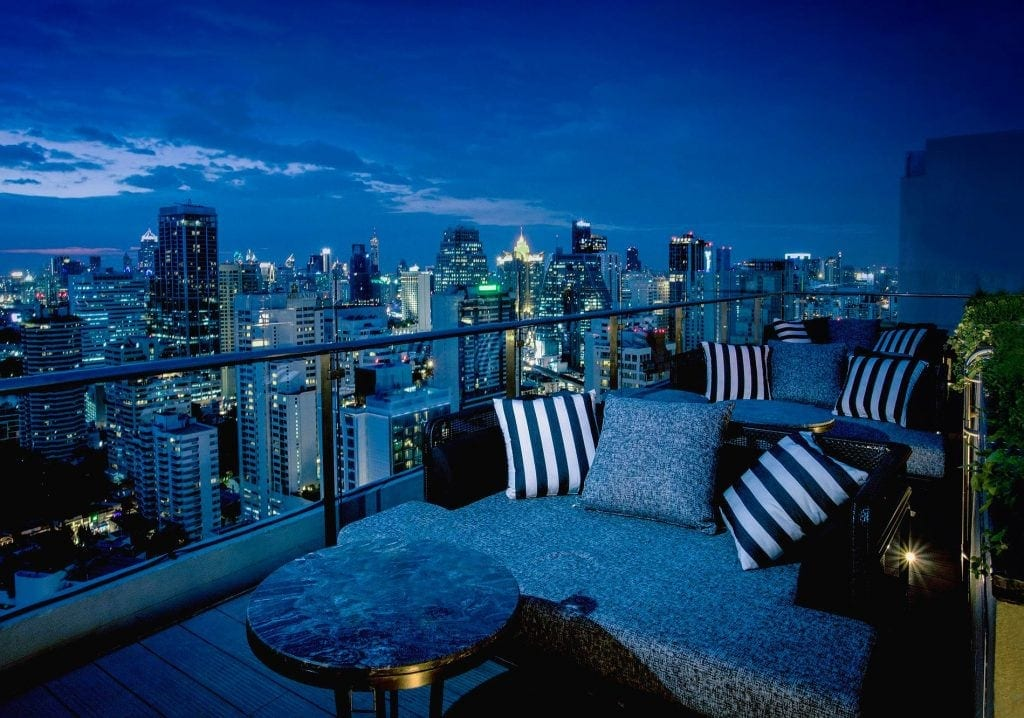Rooftop bar overlooking Bangkok night cape