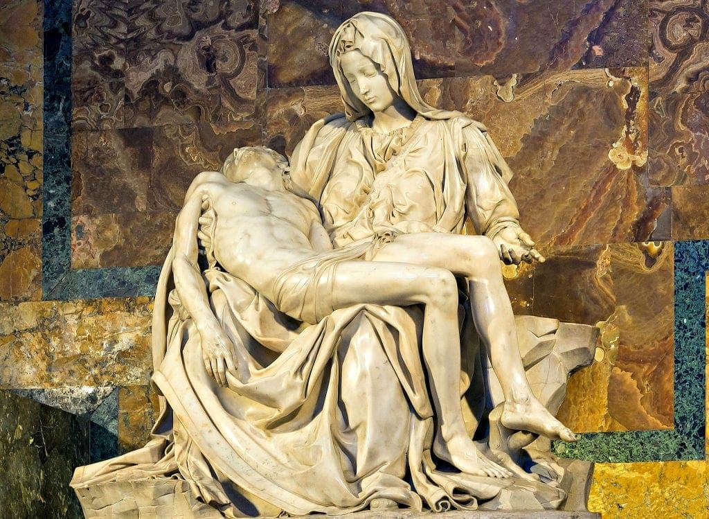 Creamy white marble statue of Mary, the mother of Christ, holding the body of her son on her lap. Meditating on sculptures help viewers with experiencing God through art and Encountering God through art
