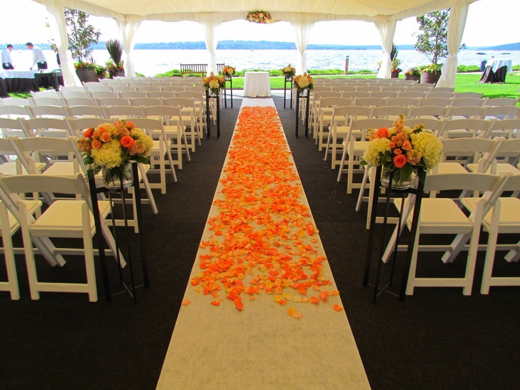 coral and peach Aisle petals. woodmark hotel