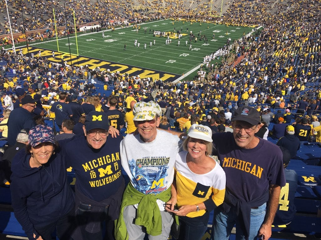Five University alumni siblings reunited from around the country to cheer on the Wolverines at the Big House. From left to right: Nancy Kushman, '87, '94; Jim Kushman, '67; John Kushman, '65, MBA'67; Cindy Kushman Hawn, '77; and Steve Kushman, '72.