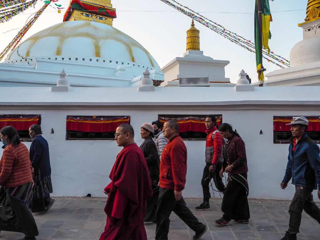 People walking around Boudha Stupa