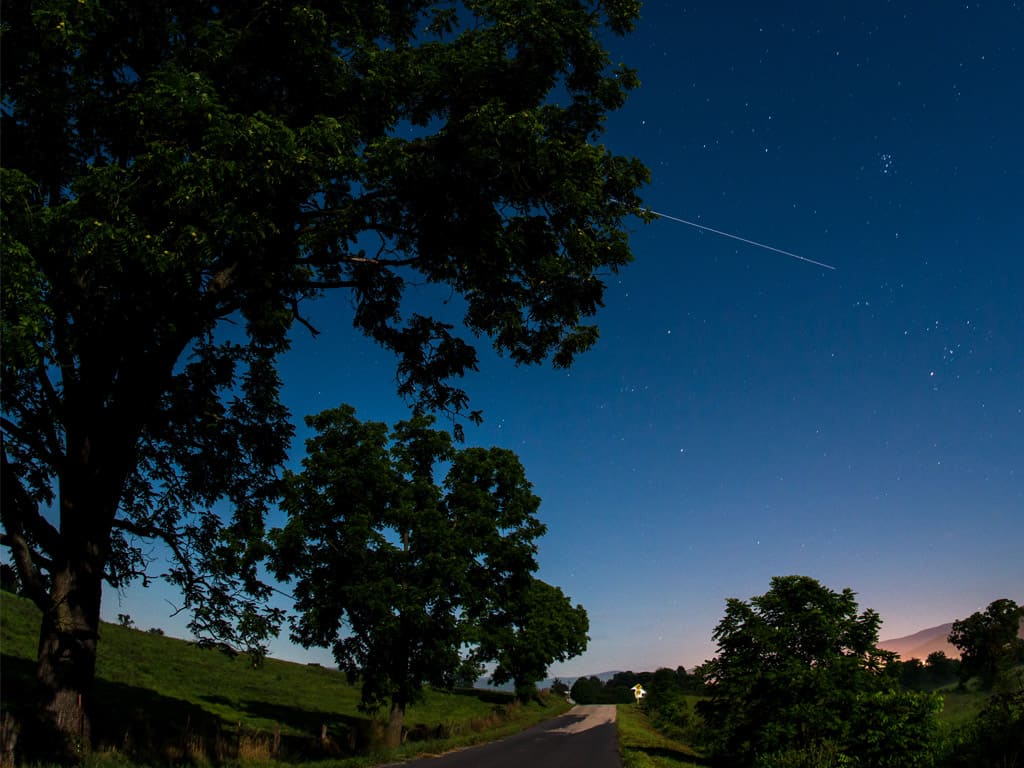 The International Space Station is seen in this 30 second exposure as it flies over Elkton, VA early in the morning, Saturday, August 1, 2015. Photo Credit: NASA/Bill Ingalls