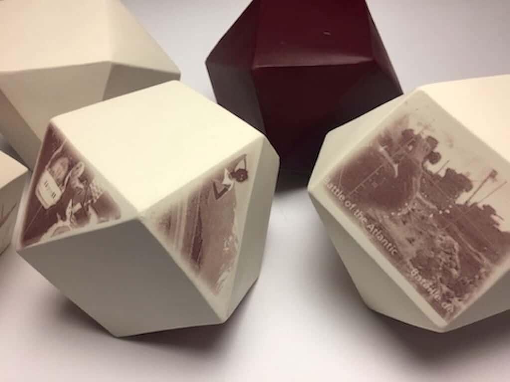 Postmarked (Detail), 14cm x 14cm x 14cm each tetrahedron, porcelain, iron-oxide decal, 2017, photo credit: Heidi McKenzie.