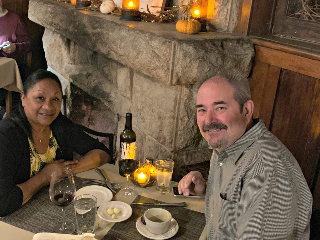 Couple site at table next to fireplace - their favorite Flagstaff restaurant