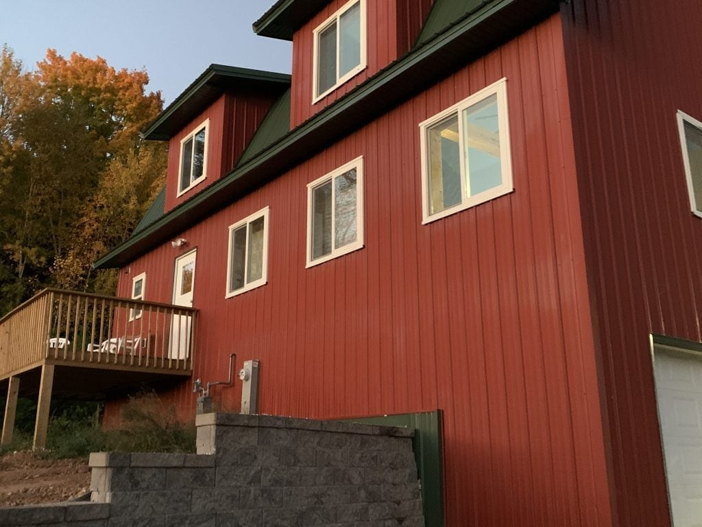 Outside of the Wisconsin Way Albergue has contemporary red barn design