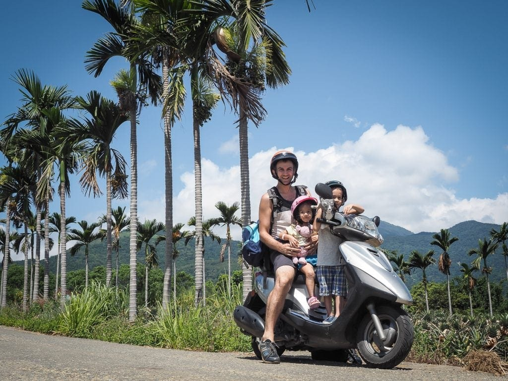 Me on a scooter with my two kids enjoy one of the best months to visit Taiwan