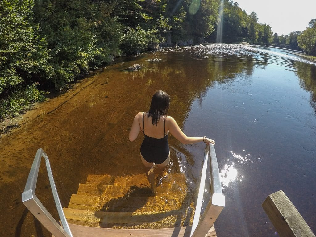 Brooke walking down the stairs into the Diable River at scandinave spa in mont-tremblant