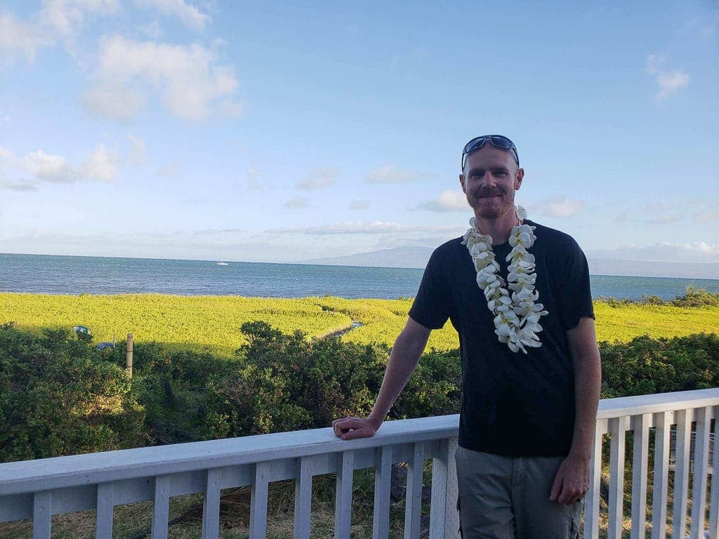 wearing leis on a porch in molokai, hawaii
