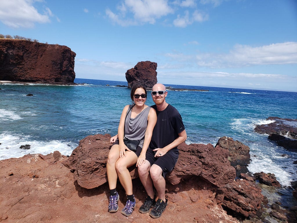 couple photo in front of sweetheart rock in lanai