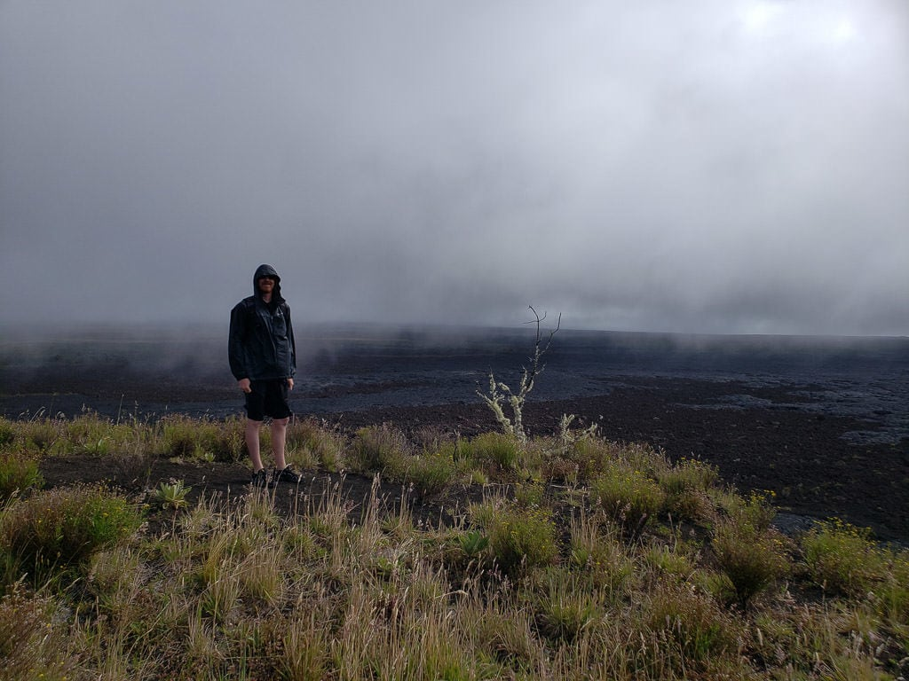 buddy with view from Pu'u Huluhulu Cinder Cone Hike near mauna kea on the big island