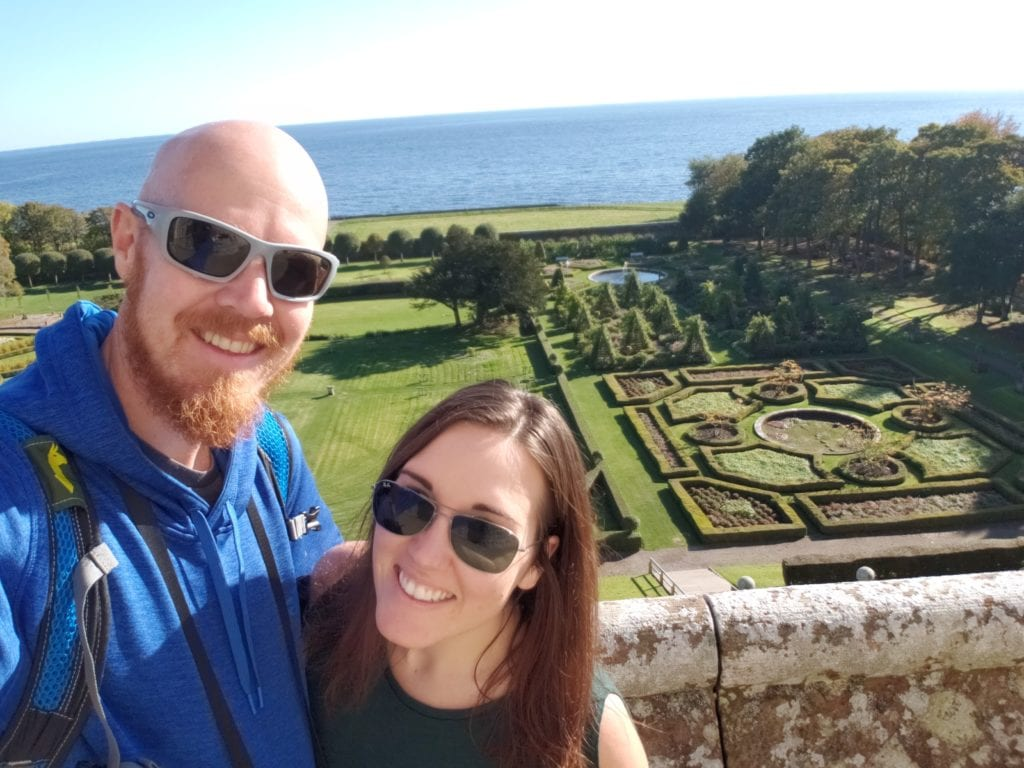 Brooke and Buddy with some of the Dunrobin Castle gardens behind them