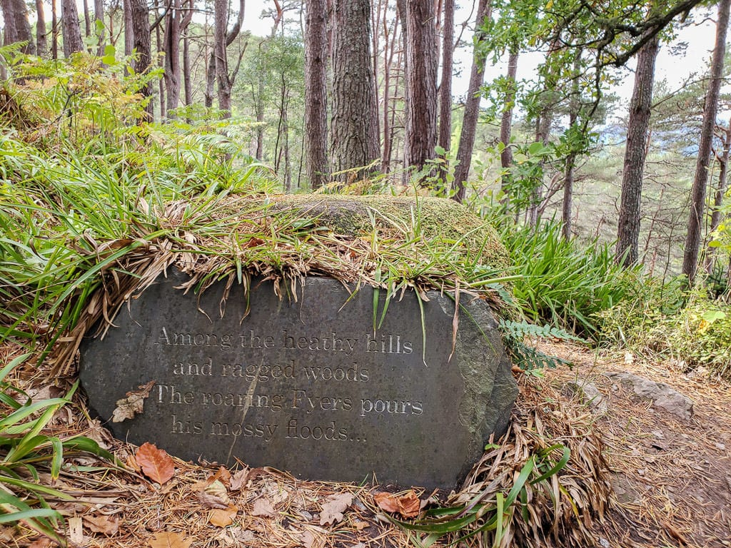 Rock with a verse carved into it on the trail to Falls of Foyers