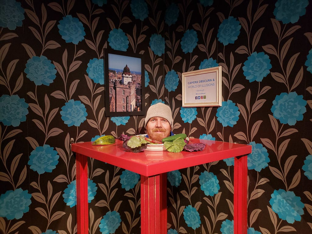 looking like a head on a platter at camera obscura in Edinburgh Scotland