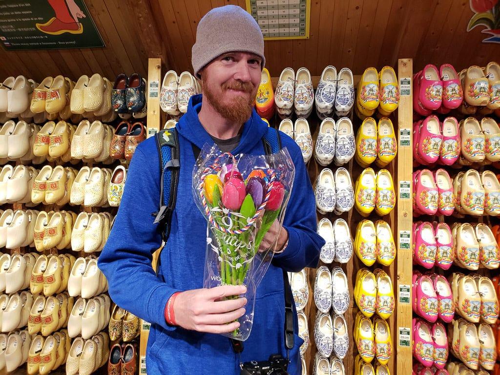 holding wooden flowers at the Dutch Wooden Shoes Workshop in Zaanse Schans
