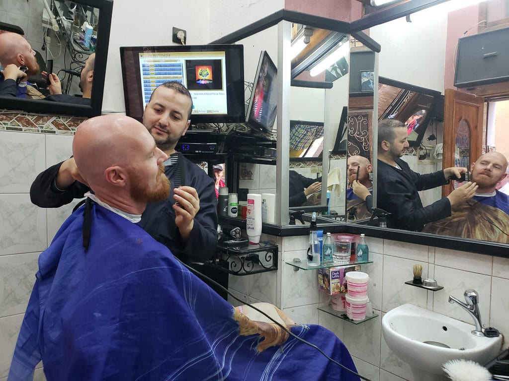 getting a cheap shave in tangier on day trip to Morocco tour