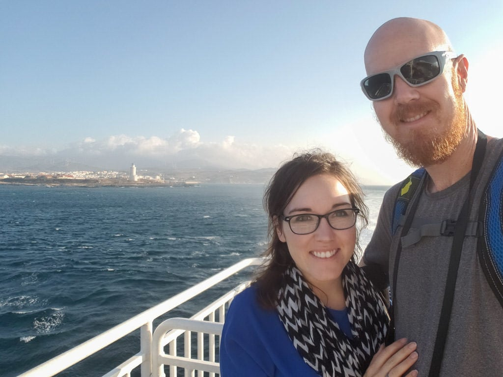 selfie with tangier behind on ferry for day trip to Morocco