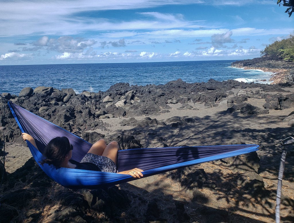 embracing island life while in a hammock in hawaii during a house sitting gig