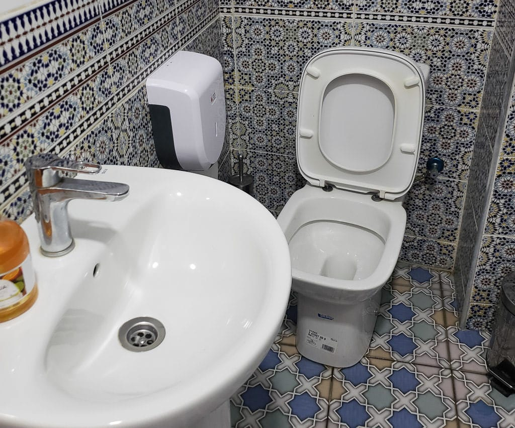 clean western-style bathroom at restaurant in tangier on day trip to Morocco tour