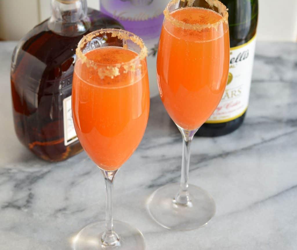 Pumpkin Fizz Cocktail in a champagne glass