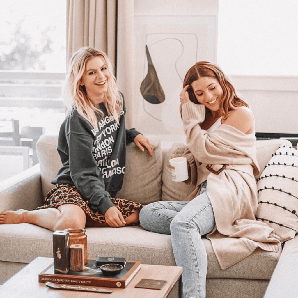 two women sitting on couch as an example of brand storytelling
