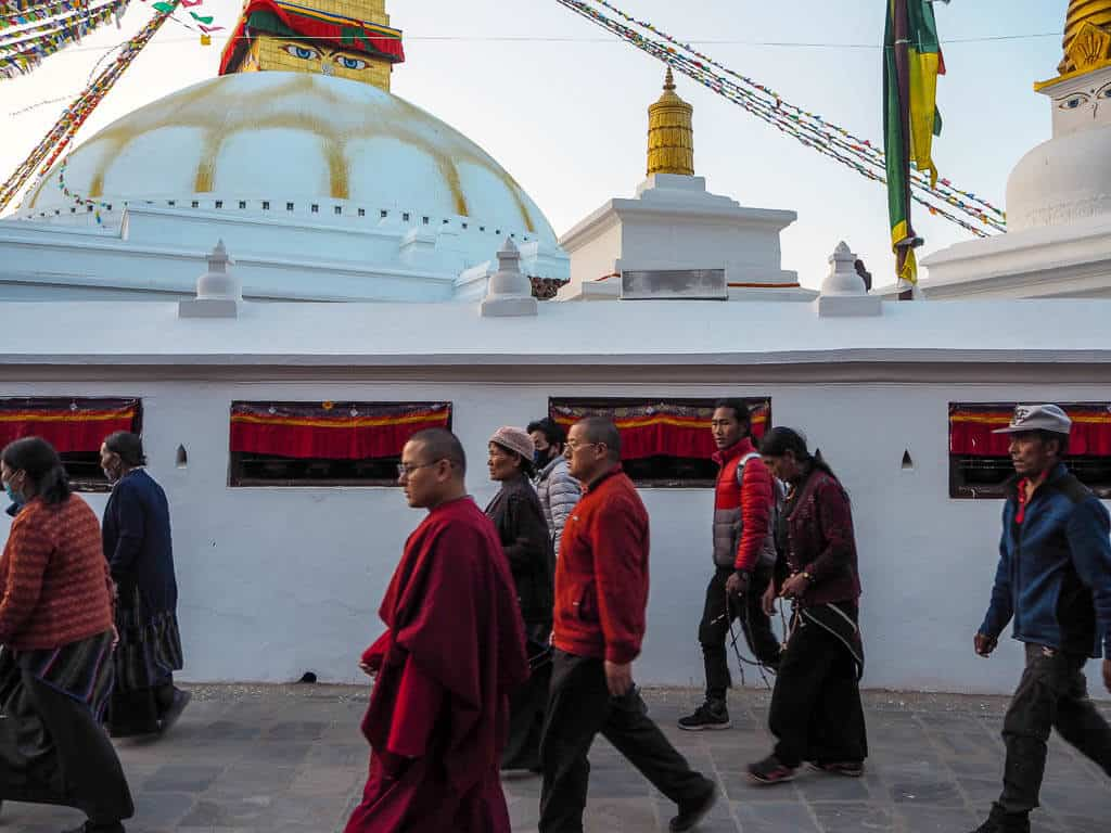 People walking around Boudha Stupa