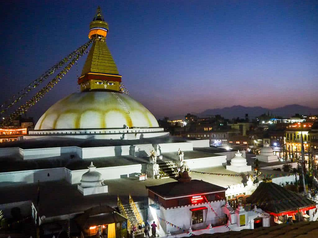 Boudha Stupa at dusk from a nearby rooftop restaurant