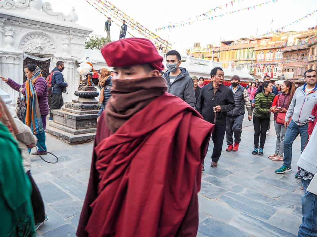 A Tibetan Monk walking around Boudha Stupa
