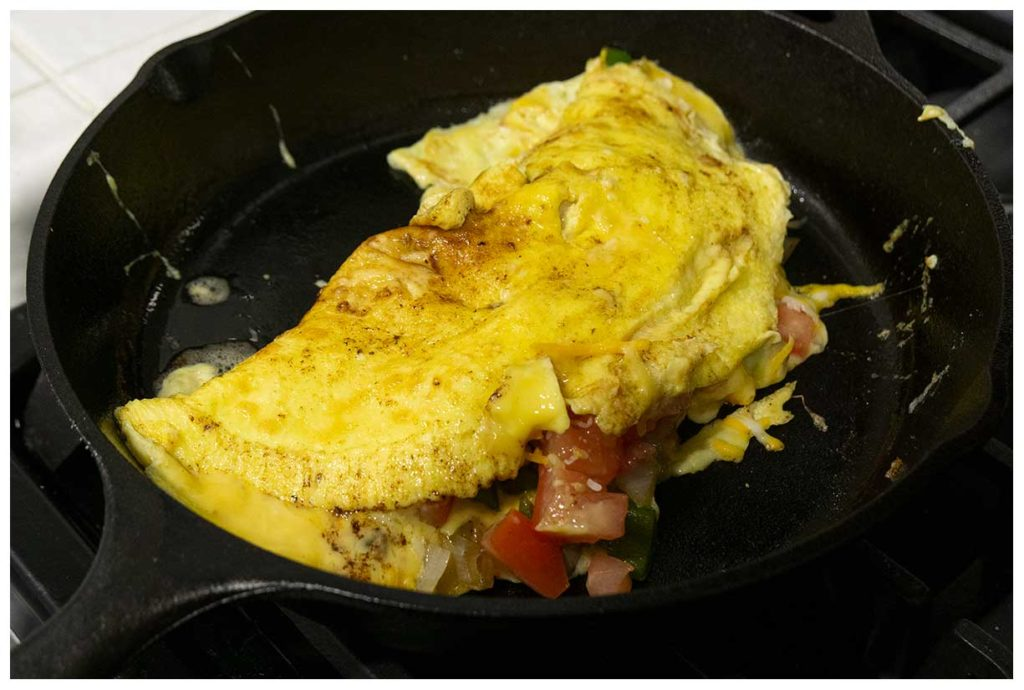 Sunday morning omelet in an iron skillet.