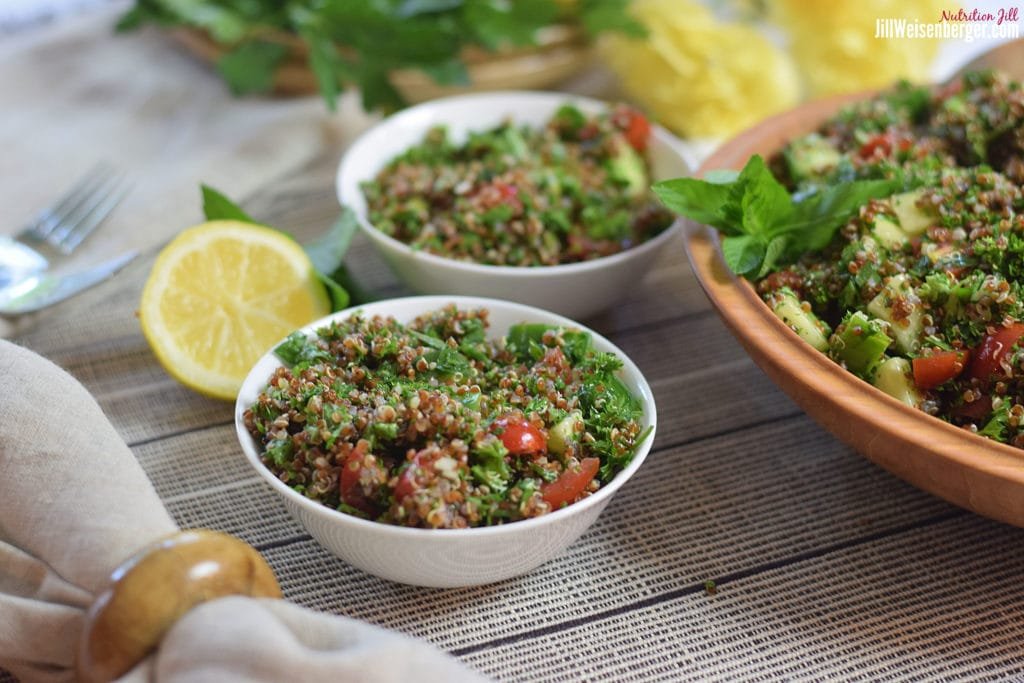 healthy quinoa tabouli salad in white bowls