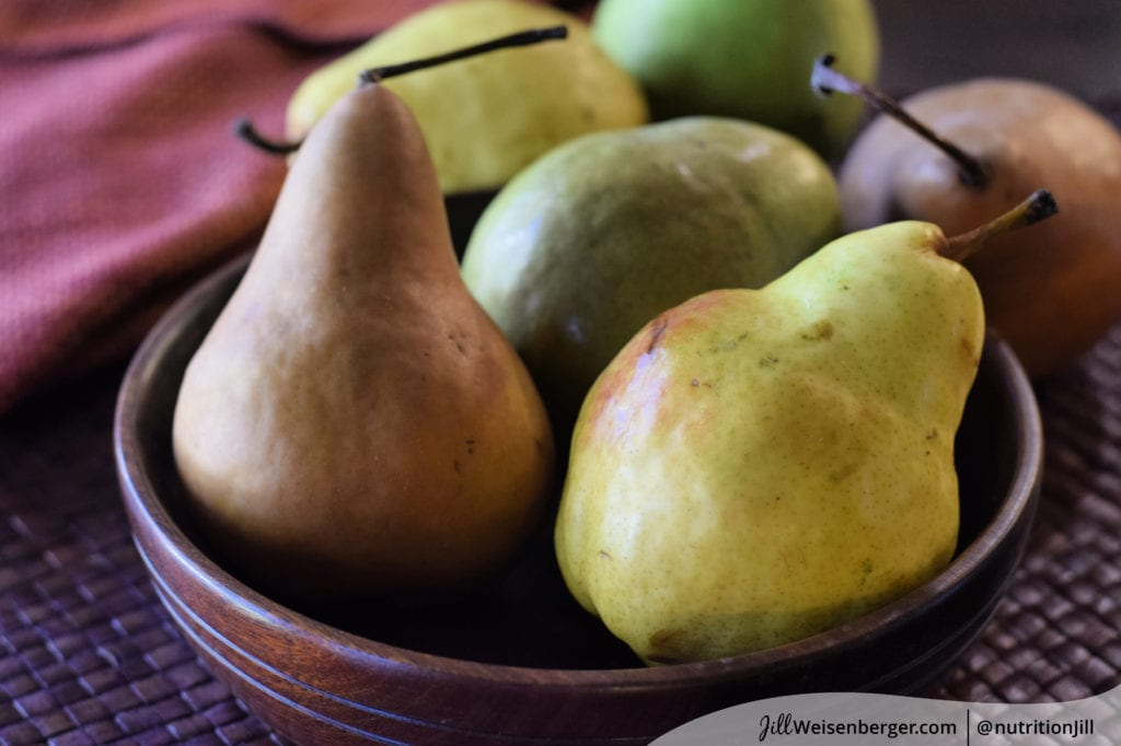 a bowl of colorful fresh pears as part of a brain healthy diet