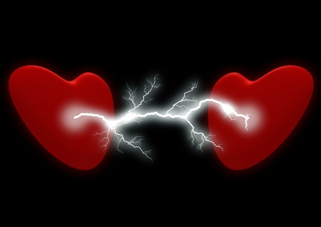 Two red hearts with lightning/electricity between them. Symbolic for how to talk to your ex.
