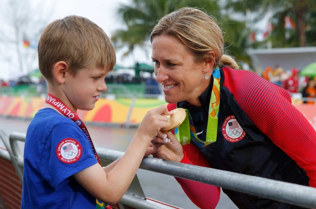 Kristin Armstrong with her son enjoying the spoils of her gold medal ride.