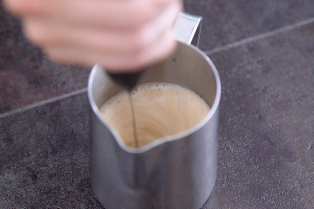 Froth pumpkin cold brew foam until fluffy