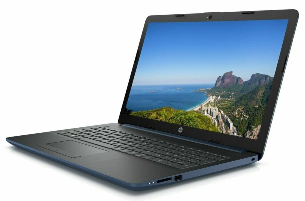 Image shows the laptop in an open position and at an angle with the sea and rock image on the screen.