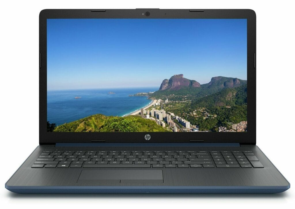 Image shows a HP laptop in an open position. The screen is displaying a sea and rock image.