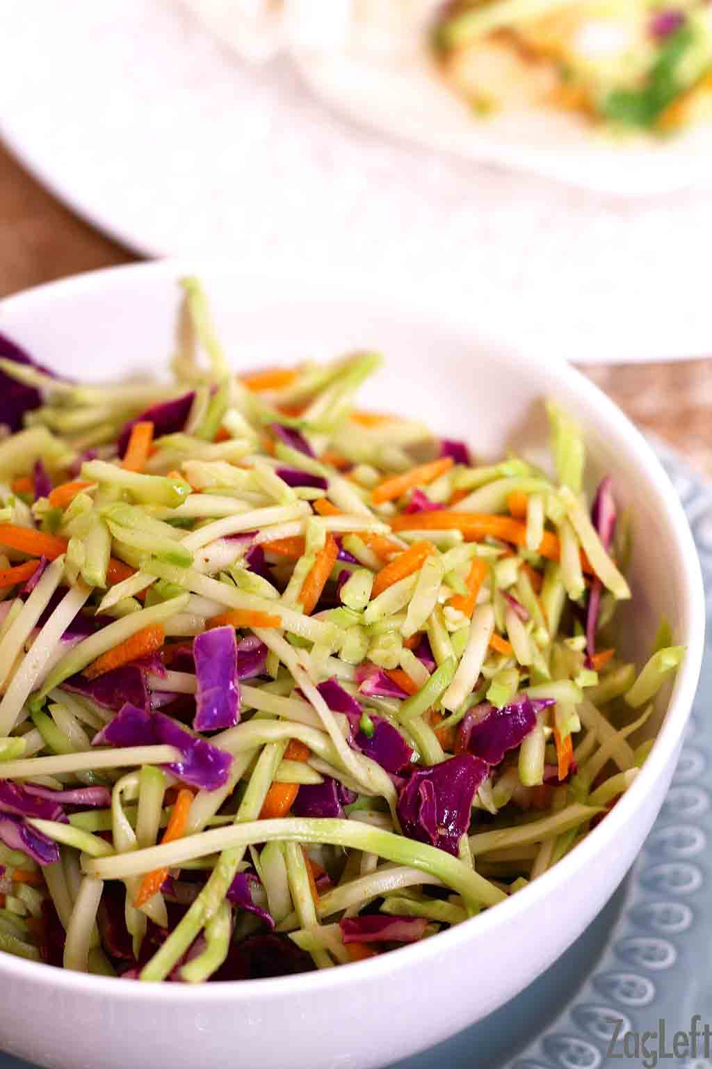 A closeup of a bowl of broccoli slaw