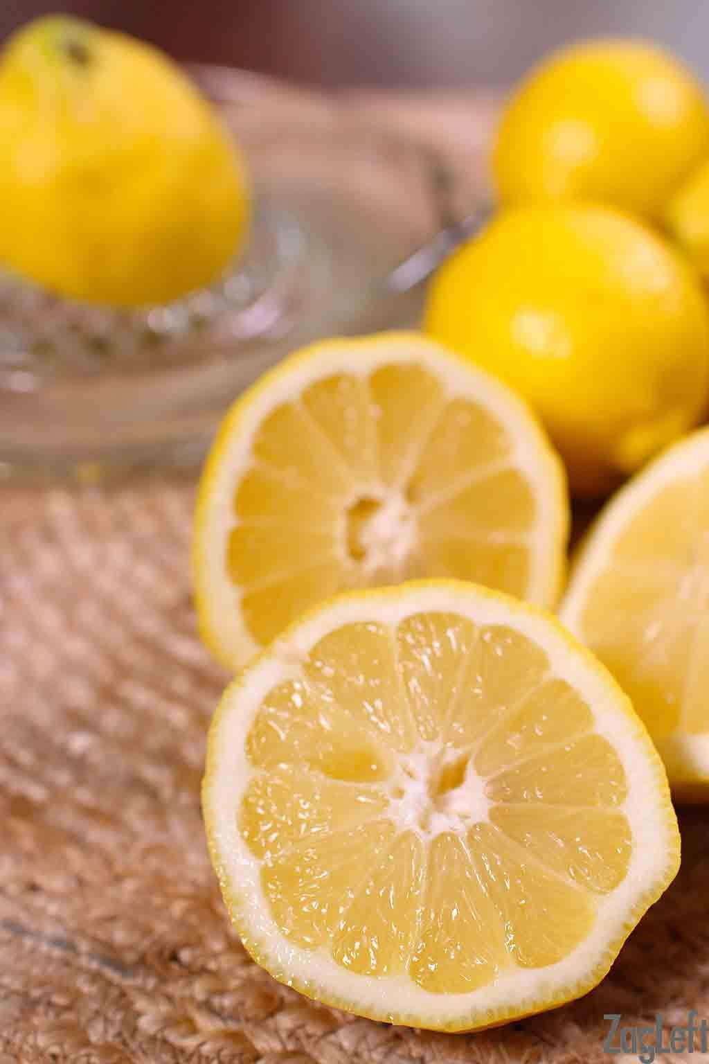 Lemons on a table cut in half