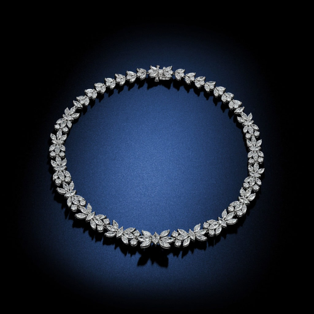 A modern take on a traditional design, this classic necklace features over 49 carats of Diamonds set into 18k white gold as beautiful floral motifs for a timeless masterpiece. Designed by David Rosenberg of Rosenberg Diamonds & Co.