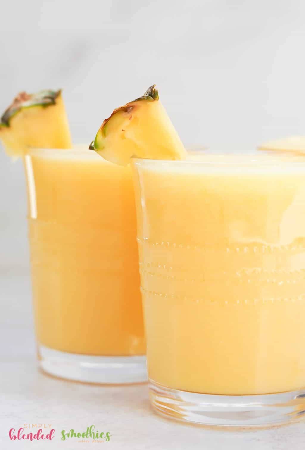 delicious and easy to make dairy-free pineapple smoothie with peaches