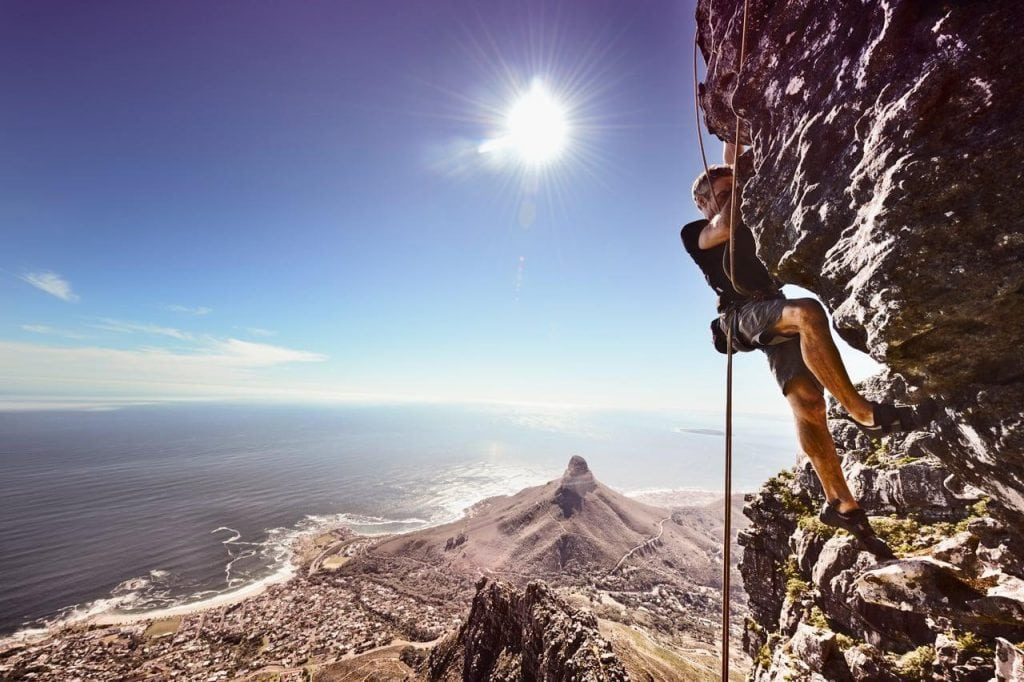 man rock climbing table mountain